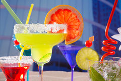 Colorful tropical cocktails in summer at city buildings Royalty Free Stock Images