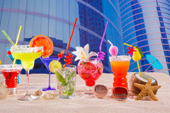 Colorful tropical cocktails in summer at city buildings Stock Images