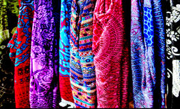 Colorful tropical fabrics on display for sale at the market Stock Images