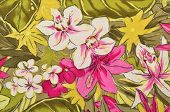 Colorful tropical floral pattern on fabric. Royalty Free Stock Photo