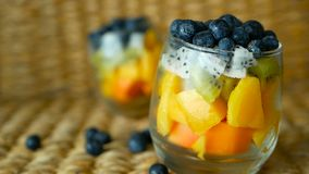 Colorful tropical mix salad in jar. Fresh various kind of raw organic berry and fruit in glass bowl. Healthy vegetarian. Eating, balanced, vegan diet. Rustic stock video
