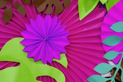 Colorful tropical paper flower background. multicolored Flowers and leaves made of paper.  royalty free stock photography