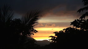 Vivid sunset over high mountains on Oriental Mindoro in Philippines. Tropical Sunset timelapse over palm tree covered mountain on the island of Mindoro in the stock video
