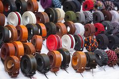 Colorful trouser belts. Many kinds of belts on white baskground royalty free stock photos
