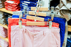 Colorful trousers on rack Royalty Free Stock Image