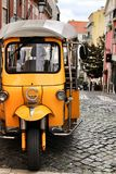 Colorful Tuk-Tuk parked in a Lisbon street royalty free stock photo