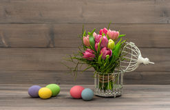 Colorful tulip flowers and easter eggs Royalty Free Stock Photos
