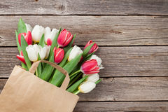 Colorful tulips in bag Royalty Free Stock Images