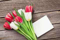 Colorful tulips bouquet and blank greeting card Royalty Free Stock Images