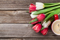 Colorful tulips bouquet and coffee cup Royalty Free Stock Photography