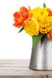 Colorful tulips bouquet in watering can Royalty Free Stock Photo