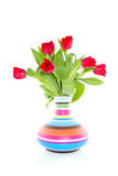 Colorful tulips in cheerful vase Stock Images