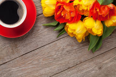 Colorful tulips and coffee cup Stock Images