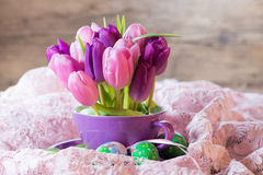 Colorful tulips with easter eggs Royalty Free Stock Images
