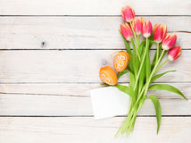 Colorful tulips, easter eggs and greeting card Royalty Free Stock Photography