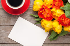 Colorful tulips, greeting card and coffee cup Royalty Free Stock Photos