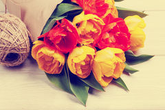 Colorful tulips over wooden table Royalty Free Stock Photo