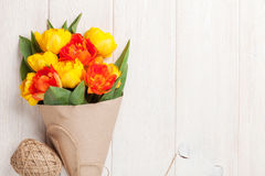 Colorful tulips over wooden table Stock Photos