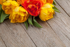 Colorful tulips over wooden table Royalty Free Stock Image