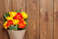 Colorful tulips over wooden table Stock Images