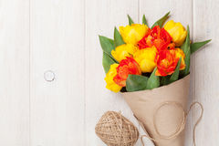 Colorful tulips over wooden table Stock Photo