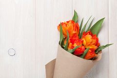 Colorful tulips over wooden table Royalty Free Stock Images