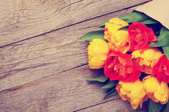 Colorful tulips over wooden table Stock Photography