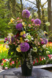 Colorful tulips, roses, narcissus, hyacinths, lily, hydrangeas, muscari flowers in vase Stock Image