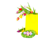 Colorful tulips in shopping bag with easter eggs Royalty Free Stock Image
