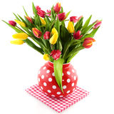Colorful tulips in spotted vase Royalty Free Stock Image