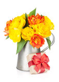 Colorful tulips in watering can and gift box Stock Image