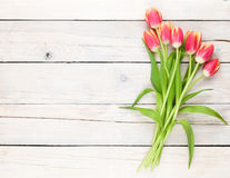 Colorful tulips on wooden table Royalty Free Stock Images