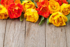 Colorful tulips on wooden table Stock Photography