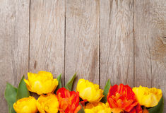 Colorful tulips on wooden table Royalty Free Stock Image