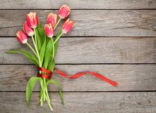 Colorful tulips on wooden table Royalty Free Stock Photo