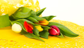 Colorful tulips on yellow Stock Image