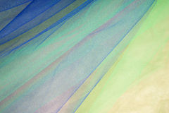 Colorful Tulle on Satin Fabric Background #4 Stock Images