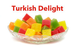 Colorful Turkish delight in crystal plate and sample text Stock Photography