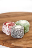 Colorful turkish delight on the kitchen wooden board Royalty Free Stock Photos