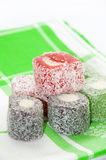 Colorful turkish delight over green tablecloth Stock Photo