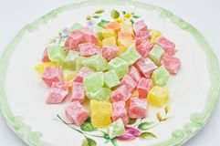 Colorful Turkish Delight in plate, kus lokumu. Isolated on white background stock photos