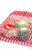 Colorful turkish delight on the red tablecloth Royalty Free Stock Photo