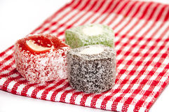 Colorful turkish delight on the red tablecloth Stock Photo