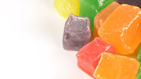 Colorful Turkish Delight on a turntable. Cubes colored marmalade on white rotate the turntable. Turkish Delight 4K stock video