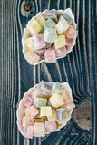 Colorful Turkish Delight on Wooden Background Royalty Free Stock Image