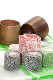 Colorful turkish delight and wooden bowls Royalty Free Stock Photography