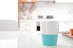 Colorful turquoise cup on a kitchen counter Stock Photos