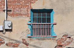 Colorful Turquoise window with exposed brick. And meter box Royalty Free Stock Photo