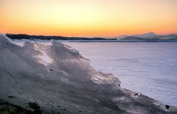 Colorful twilight over frozen lake Stock Photography