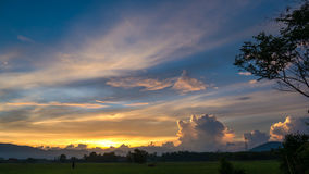 Colorful twilight sky over rice field Stock Photo
